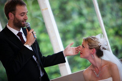 Groom making wedding speech with Bride