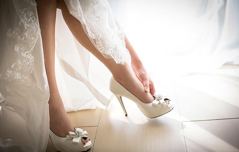 Bride trying on shoes